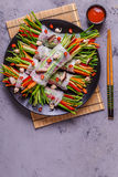 Spring rolls with vegetables and shiitake mushrooms on a plate. Royalty Free Stock Images