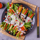 Spring rolls with vegetables and shiitake mushrooms on a plate. Stock Images