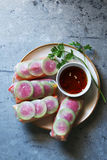 Spring rolls with vegetables on a wooden board served with soy sauce Stock Image