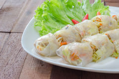 Spring rolls on white plate,wooden background Stock Photography