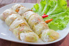 Spring rolls on white plate,wooden background Stock Images