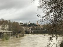 The river Tiber in spring under the cloudy skies royalty free stock images