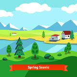 Spring rural farm riverside scenic with mountains Stock Photo