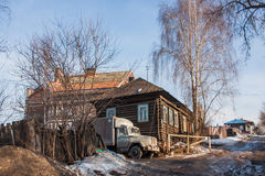Spring rural landscape with wooden house and a truck Royalty Free Stock Photography