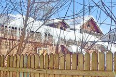 Spring in the Russian province. Suck dangling from the roof of a wooden house in the Russian province Stock Images