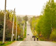 In spring it`s time to walk around. The leaves of the trees are new and of a beautiful soft green. Photo taken on May 7, 2015, Drummondville, Quebec, Canada Royalty Free Stock Photography