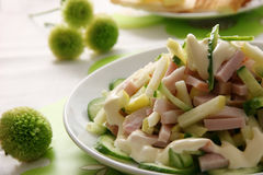 Spring salad. Salad made of ham, apples and fresh cucumbers Royalty Free Stock Photos