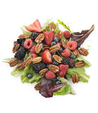 Spring Salad With Berries And Peanuts. On White Background royalty free stock image