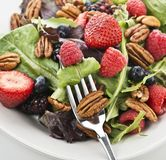 Fresh salad leaves with berries and peanuts. Spring Salad leaves With Berries And Peanuts,Close Up royalty free stock images