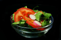 Spring Salad On Black Background Royalty Free Stock Photos