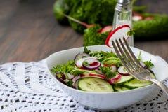 Spring salad of radishes, cucumbers Stock Photo