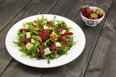 Spring salad with strawberries, rocket salad, parmesan cheese, w Royalty Free Stock Photography