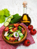 Spring salad with tomato, cucumbers and radish Royalty Free Stock Photography