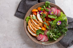 Spring salad with vegetables, chicken breast and edible flowe Royalty Free Stock Photography