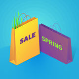 Spring sale background. On the illustration are shopping bags and grass. Isometric vector. Spring colorful sale illustration on blue background. On the Royalty Free Stock Photos