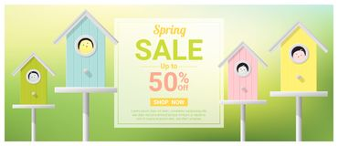 Spring sale banner with little birds in colorful birdhouses Stock Photos