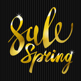 Spring Sale. Gold inscription paint. glitz, glamor, light, shine, discounts Stock Image