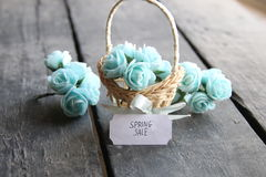 Spring sale idea. Rustic still life, roses and tag. Royalty Free Stock Photography