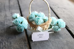 Spring sale idea. Rustic still life, roses and tag. Royalty Free Stock Photo