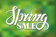 Spring sale.Lettering on Green  blurred background Stock Photo