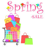 Spring sale marketing template with shopping trolley and shopping bags Royalty Free Stock Image