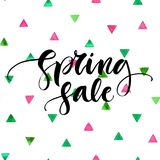 Spring sale - modern poster with hand written text and watercolor brush triangles background. Vector illustration. Royalty Free Stock Photo