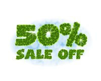 Spring sale 50 percent off. Letters and figures from maple leaves on a heavenly background with the effect of bokeh and. Spring sale 50 percentoff. Letters and Stock Photography