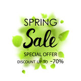 Spring sale placard template for card, placard, flyer, banner, brochure. Green blurred leafs on white background. Royalty Free Stock Image