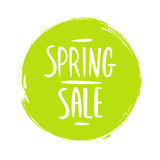 Spring Sale sign with handwritten text design and green circle brush stroke background. Royalty Free Stock Image