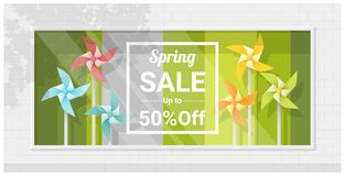 Spring sale window display with colorful pinwheels background Royalty Free Stock Images