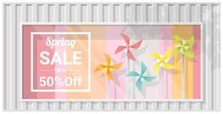 Spring sale window display with colorful pinwheels background Royalty Free Stock Image