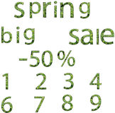 Spring sale words and numbers whit leaves. Royalty Free Stock Photo