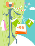Spring sales. A young girl has acquired a lot of good products at discounted prices Stock Photography