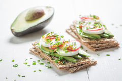 Spring sandwich with avocado, chive and eggs Stock Images
