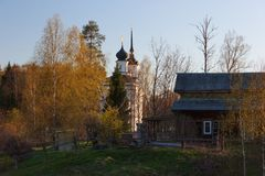 Church, country house and spring birch trees stock photo