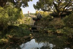 Spring scenery at ancient Chinese garden in Wuxi city. Spring scenery at classical Jichang Garden in eastern Chinese city of Wuxi, Jiangsu province. Photo taken Royalty Free Stock Photo