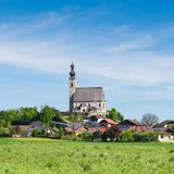 Spring scenery with rural Catholic church and small Bavarian village Stock Photography