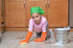 Spring Scrubbing. Little girl scrubbing tile floor spring cleaning Royalty Free Stock Photos