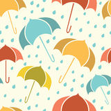 Spring seamless pattern with umbrellas and rain isolated on beige background Stock Photography