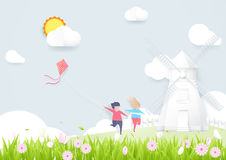 Spring season concept. Boy and girl playing kite with Windmills. Paper art style design Stock Images
