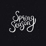 Spring Season Phrase on a Dotted Black Background Royalty Free Stock Image