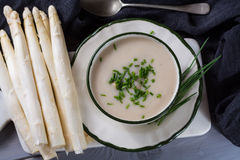 Spring season - white  asparagus soup with fresh green chives re Stock Photography