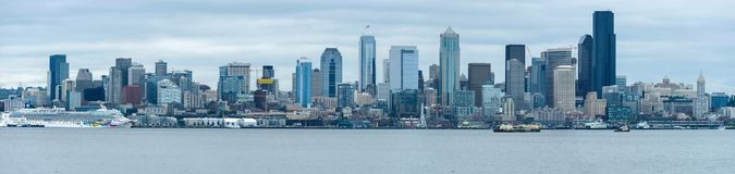 Spring Seattle Skyline. Seattle, Washington, USA - May 28, 2016: A spring cloudy day`s panoramic view of Seattle Downtown skyline, looking from Alki Beach Royalty Free Stock Photos