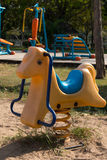 Spring See Saw in the park rocking Horse royalty free stock image