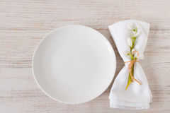 Spring setting table with plate and napkin, close up Royalty Free Stock Image