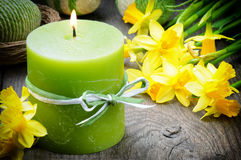 Spring setting with yellow narcissus and candle Stock Photo