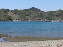 Spring at Shiranui Sea. Blue seawater at the bay of Shiranui sea in spring at a small town in Japan Stock Photography