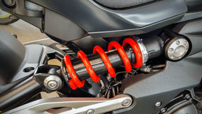 Spring and shock absorber of motorcycle. Royalty Free Stock Image