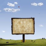Spring Sign. Giant empty sign in a fantasy landscape Royalty Free Stock Image