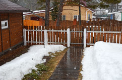 Spring sleet in the village. Inner yard of country house. Siberia, Russia Stock Photography